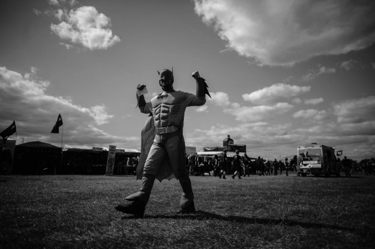 A heavy metal fan dressed as Batman plays to the camera during the Bloodstock Outdoor Heavy Metal Festival on August 10, 2013 in Walton Upon Trent, Derbyshire, England. Thousands of heavy metal fans from across Britain attended the country's biggest metal festival which features both established and unsigned bands over four days. (Christopher Furlong/Getty Images)