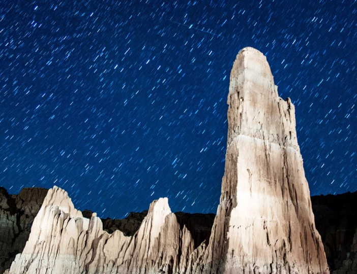 Perseid meteors streak across the sky on August 12, 2013 in Cathedral Gorge State Park, Nevada. The annual display, known as the Perseid shower because the meteors appear to radiate from the constellation Perseus in the northeastern sky, is a result of Earth's orbit passing through debris from the comet Swift-Tuttle. (Ethan Miller/Getty Images)