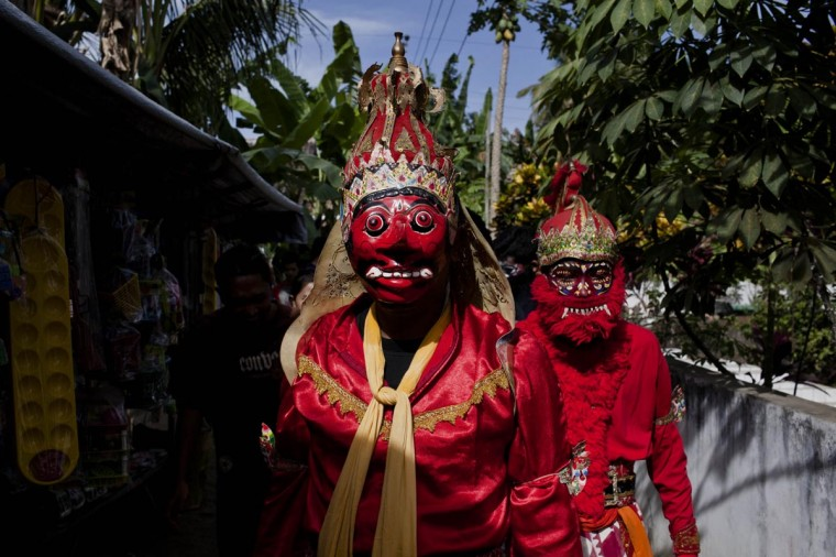 Members of the Reog Ria Kelana Muda group prepare for their performance on August 13, 2013 in Yogyakarta, Indonesia. Reog is a traditional Indonesian dance which originated on Java Island and performed as part of the Eid Al-Fitr celebrations which mark the end of Ramadan. The dancers have reported becoming possessed by magical powers and supernatural spirits during the performance. (Ulet Ifansasti/Getty Images)