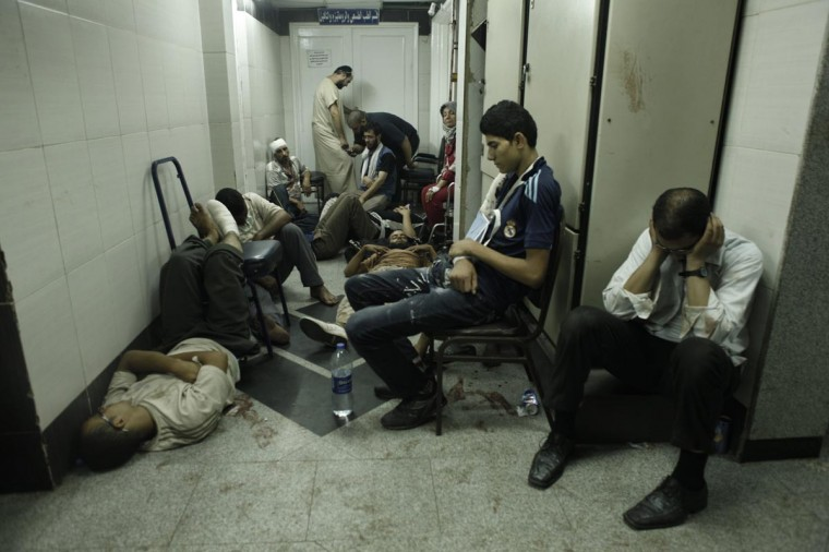 Supporters of deposed Egyptian President Mohammed Morsi lie wounded on the floor of the Rabaa al-Adaweya Medical Centre in the Nasr City district on August 14, 2013 in Cairo, Egypt. (Ed Giles/Getty Images)