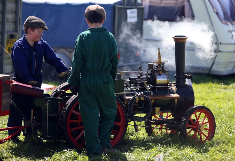 Two young exhibitors prepare their miniature steam engine to shows at the Cornish Steam and Country Fair at the Stithians Showground on August 16, 2013 near Penryn, England. The annual show, now in 58th year, is one of Cornwall's largest outdoor events and is one of the UK's most popular and respected steam rallies. (Matt Cardy/Getty Images)