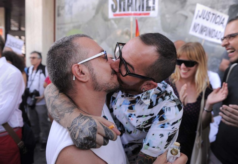 Two men kiss to protest against Russian anti-gay laws during a demonstration opposite the Russian embassy in Madrid, Spain. Protestors are demanding the cancellation of the 2014 Winter Olympics in Sochi, Russia. (Denis Doyle/Getty Images)