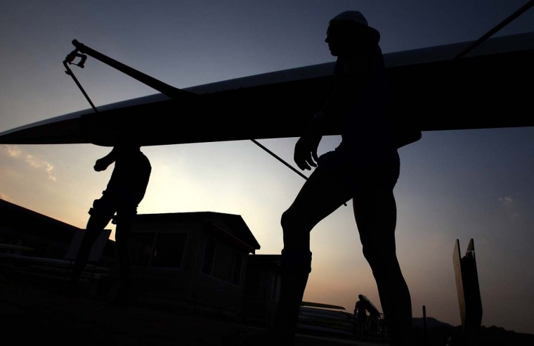 Crews remove their boats from the water after a training session day two of the 2013 World Rowing Championships on August 26, 2013 in Chungju, South Korea. (Chung Sung-Jun/Getty Images)