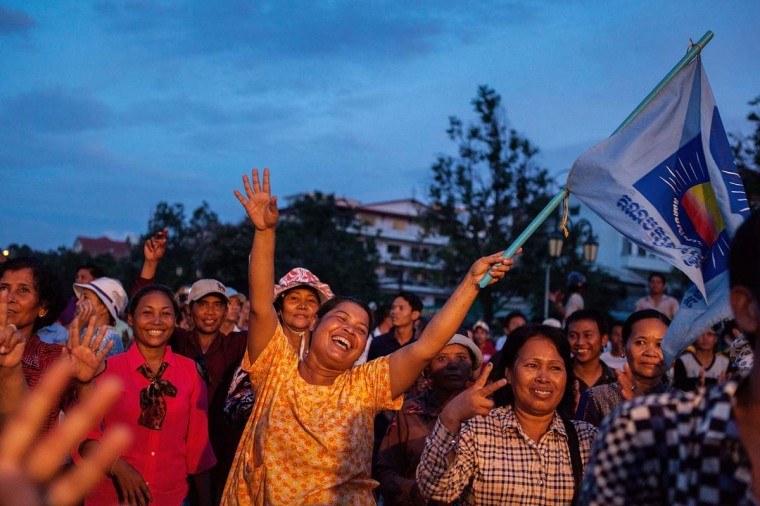 Crowds gather to support Cambodian opposition leader Sam Rainsy and Vice President Kem Sokha at Freedom Park on August 26, 2013 in Phnom Penh, Cambodia. Cambodian opposition leader Sam Rainsy and Vice President Kem Sokha spoke to a crowd of around 10, 000 supporters, where they called on supporters to gather in Phnom Penh for mass demonstrations if an independent commission is not set up to investigate election results. (Nicolas Axelrod/Getty Images)