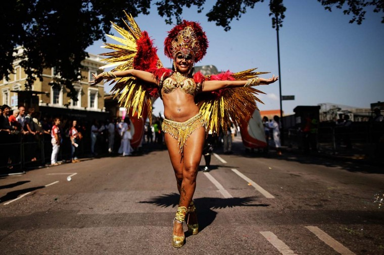Performers parade past the judges position at the start of the Notting Hill Carnival on August 26, 2013 in London, England. More than one million people are expected to enjoy this year's Notting Hill Carnival. It is the largest street festival in Europe and was first held in 1964 by the Afro-Caribbean community. Over the bank holiday weekend the streets come alive to steel bands, colourful floats and costumed performers as members of the public flood into the area to join in the celebrations. (Matthew Lloyd/Getty Images)