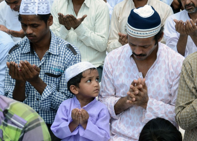 Indian Muslims pray as they gather for Jummat-Ul-Vida prayers on the last Friday of Ramadan at the historic Jama Masjid in New Delhi on August 2, 2013, ahead of the Eid al-Fitr festival. The three-day festival, which begins after the sighting of the new moon, marks the end of the Muslim fasting month of Ramadan, during which devout Muslims abstain from food, drink, smoking and sex from dawn to dusk. (Raveendran/AFP/Getty Images)