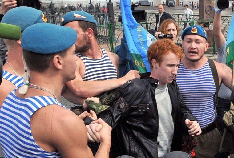 Russian paratroopers scuffle with gay rights activist Kirill Kalugin (center), who conducted a one-man protest against LGBT rights violations in St. Petersburg on August 2, 2013 during the celebration of Paratroopers Day. (Olga Maltseva/AFP/Getty Images)