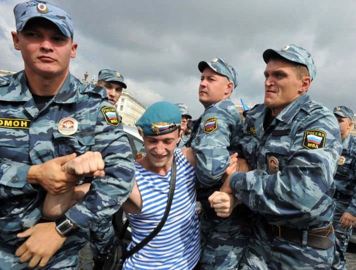Russian riot police detain a veteran paratrooper who scuffled with a gay rights activist on August 2, 2013 in St. Petersburg during the celebration of Paratroopers Day. Russian paratroopers fought with activist Kirill Kalugin, who stood protesting against LGBT rights violations during the celebration. (Olga Maltseva/AFP/Getty Images)