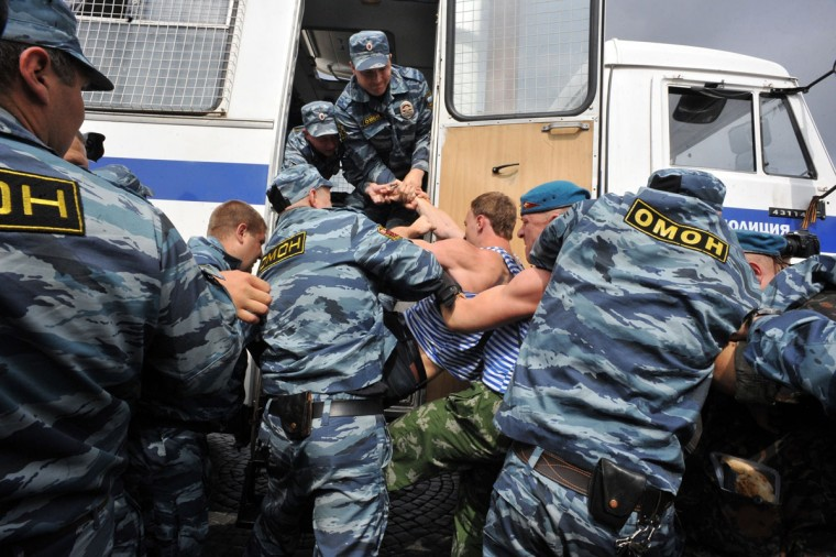 Russian riot police detain paratrooper veterans on August 2, 2013 in St. Petersburg. Russian paratroopers scuffled with LGBT rights activist Kirill Kalugin, who stood protesting against gay rights violations during the celebration. (Olga Maltseva/AFP/Getty Images)