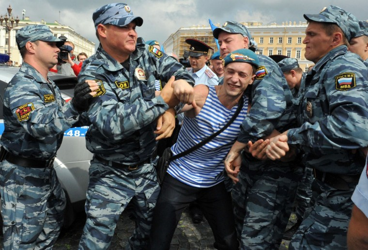 Russian riot police detain a paratrooper veteran on August 2, 2013 in St. Petersburg. Russian paratroopers scuffled with LGBT rights activist Kirill Kalugin, who stood protesting against gay rights violations during the celebration. (Olga Maltseva/AFP/Getty Images)