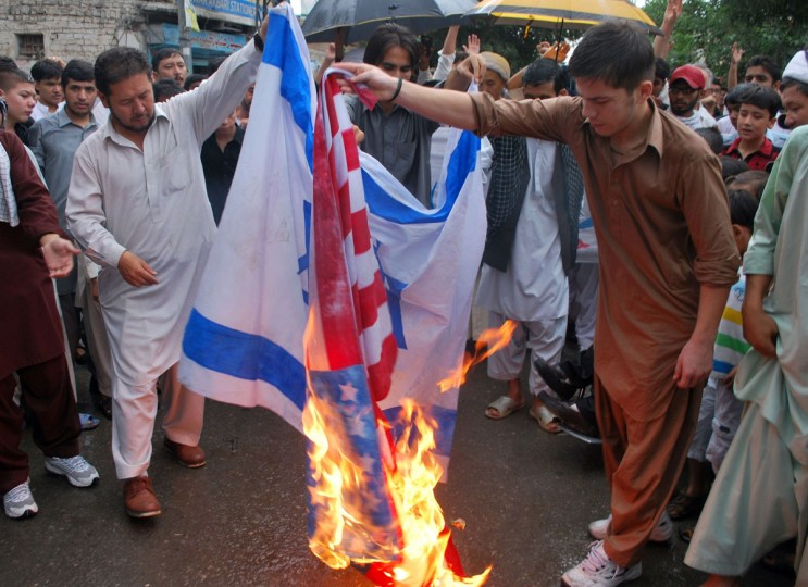 Pakistani Shiite Muslims torch Israeli and U.S. flags during a rally to mark the Al-Quds Day on the last Friday in the holy month of Ramadan in Quetta on August 2, 2013. Shiite Muslim protesters rallied across the country against the United States and Israel and prayed for the liberation of Palestine. (Banaras Khan/AFP/Getty Images)