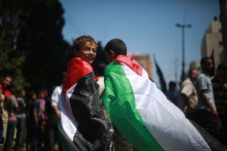 """Palestinian and foreign protestors attend a gathering marking """"Al-Quds (Jerusalem) International Day"""" in Gaza City on August 2, 2013. An initiative started by Iranian revolutionary leader Ayatollah Ruhollah Khomeini, Quds Day is held annually on the last Friday of the Muslim fasting month of Ramadan and calls for Jerusalem to be returned to the Palestinians. (Mohammed Abed/AFP/Getty Images)"""