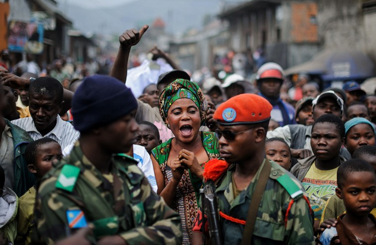 A woman reacts to the arrival of Colonel Mamadou, commander of the 42nd battalion of the Congolese armed forces (FARDC), as he tries to disperse a demonstration in Goma in the east of the Democratic Republic of the Congo on August 2, 2013. Several hundred angry civilians stoned UN vehicles and called for the UN to leave the country due to a feeling of inaction by UN forces. (Phil Moore/AFP/Getty Images)