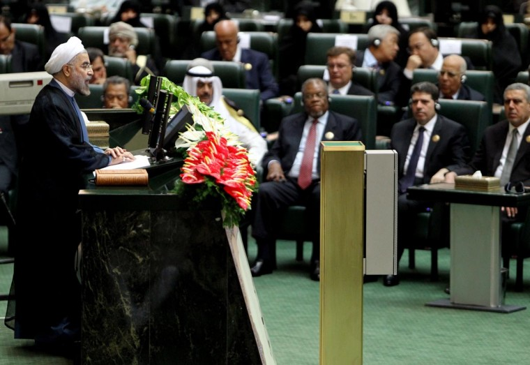 Iran's President Hasan Rowhani (L) delivers a speech after being sworn in before parliament in Tehran on August 4, 2013. Rowhani revealed a cabinet lineup of experienced technocrats, aiming to deliver on his promise of saving the economy and engaging the world. (Atta Kenare/AFP/Getty Images)