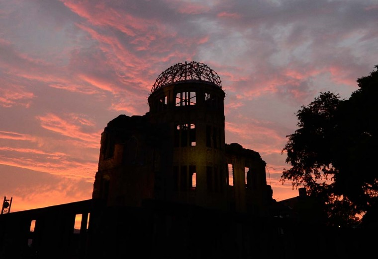 The Atomic Bomb Dome is seen in silhouette during sunset over the Peace Memoral Park in Hiroshima on August 5, 2013. Tens of thousands of people were expected to gather at a peace memorial park in Hiroshima on August 6 to mark the 68th anniversary of the US atomic bombing of the Japanese city. (Toru Yamanak/AFP)