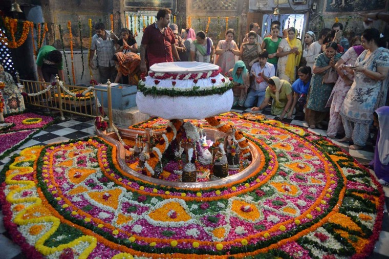 Indian Hindu devotees pay their respects to the eleven Shivlinga of Lord Shiva at the historical Shivala Veer Ban for Sawan Somvar in Amritsar on August 5, 2013. Sawan is the fifth month of the Hindu calendar and is considered the holiest month of the year. Sawan Somvar or Shravan Somvar (July - August) is an observance dedicated to Lord Shiva. (Nanu Narinder/AFP)