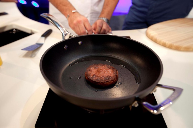 In this handout picture received via Ogilvy PR, British Chef Richard McGeown cooks the world's first lab-grown beef burger in London on August 5, 2013. (David Parry via AFP/Getty Images)