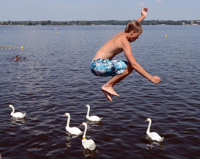 A boy jumps into the water at a forbidden place on Zegrze lake near Warsaw, Poland on August 6, 2013. Thirty-five people have drowned in Poland since the beginning of August, according to police, as Poles attempt to combat a heatwave by flocking to the beach. (Janek Skarzynski/AFP/Getty Images)