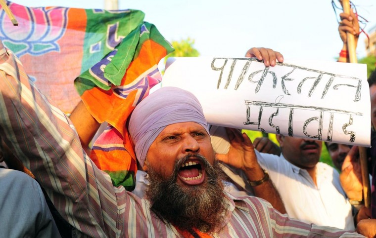A Bharatiya Janata Party activist shouts anti-Pakistan slogans during a protest against the death of five Indian Army soldiers during an ambush in Kashmir blamed on the Pakistani army, in Allahabad on August 6, 2013. India accused Pakistan's military of involvement in an ambush on an army post in disputed Kashmir which killed five soldiers and punctured hopes of a resumption in peace talks. (Sanjay Kanojia/AFP/Getty Images)