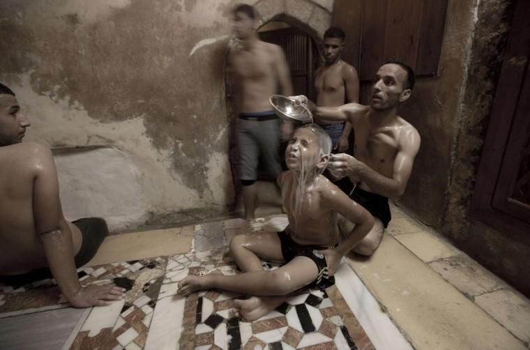 Palestinians relax inside the Hamam al-Sammara Public Baths during preparations for the Eid Al-Fitr feast in Gaza city on Aug 07, 2013. (Mahmud Hams/AFP/Getty Images)