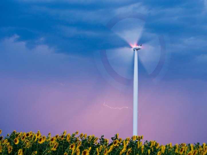 A strike of lightning illuminates the sky behind a wind turbine above a field of sunflowers near Sieversdorf, Germany, on August 8, 2013. (Patrick Pleul/AFP/Getty Images)
