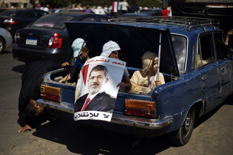 Egyptian children hold a portrait of ousted president Mohamed Morsi as they sit in a trunk of a car, during a demonstration in support of Morsi in Cairo, on August 9, 2013. Islamist supporters of deposed Egyptian president Mohamed Morsi planned new rallies as the interim premier suggested a crackdown on their protest camps was imminent. (Gianluigi Guercia/AFP/Getty Images)