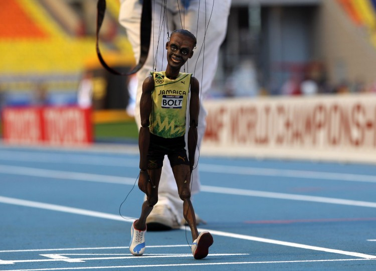 A puppet depicting Jamaican sprinter Usain Bolt is paraded around the Luzhniki Stadium in Moscow on August 9, 2013 ahead of the 2013 IAAF World Championships being held from August 10 to 18. (Adrian Dennis/AFP/Getty Images)