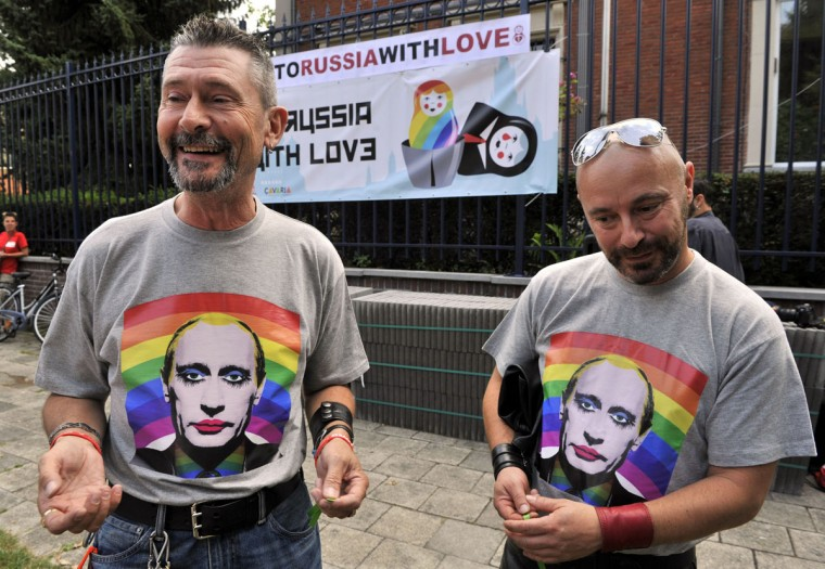 """A same-sex couple takes part in a """"Kiss-In"""" action by more than 300 gay and lesbian supporters in front of the Russian consulate in Antwerp, Belgium to protest against the treatment of LGBT people in Russia on August 9, 2013. (Georges Gobet/AFP/Getty Images)"""