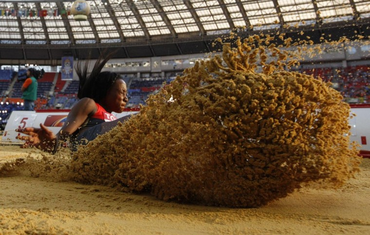 Sostene Moguenara of Germany jumps during the women's long jump event at the 2013 IAAF World Championships at the Luzhniki stadium in Moscow on August 10, 2013. (Adrian Dennis/AFP/Getty Images)