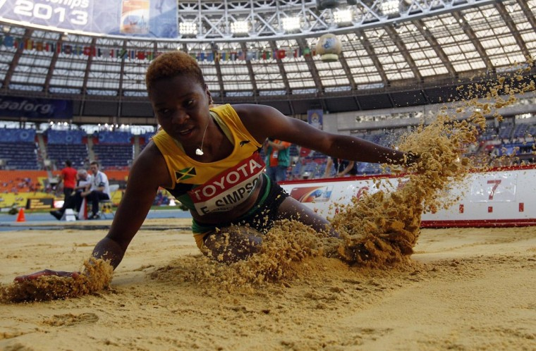 Francine Simpson of Jamaica lands during the women's long jump event at the 2013 IAAF World Championships at the Luzhniki stadium in Moscow on August 10, 2013. (Adrian Dennis/AFP/Getty Images)