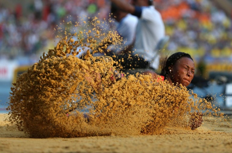 Germany's Sostene Moguenara competes in the women's long jump event at the 2013 IAAF World Championships at the Luzhniki stadium in Moscow on August 10, 2013. (Adrian Dennis/AFP/Getty Images)