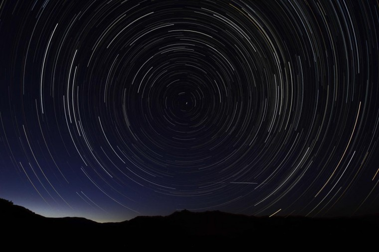 A multiple exposure picture taken in the early hours of August 11, 2013 shows a Perseids meteor shower in the sky, near the municipality of La Hiruela, on the mountains of the Sierra Norte de Madrid. (Dani Pozo/AFP/Getty Images)