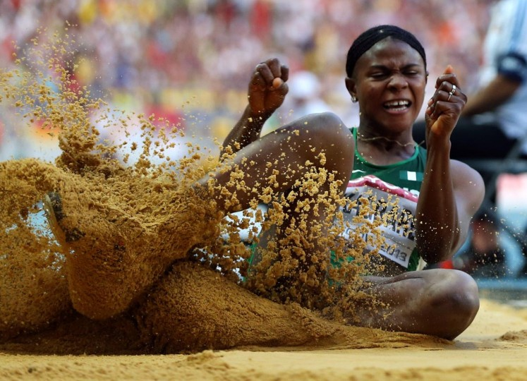 Nigeria's Blessing Okagbare competes during the women's long jump final at the 2013 IAAF World Championships at the Luzhniki stadium in Moscow on August 11, 2013. (Adrian Dennis/AFP/Getty Images)