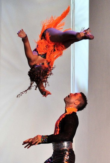 Colombian Salsa dancers Jhon Herrera (Down) and Liseth Ledesma participate in the Cabaret couples category during the VIII World Salsa Festival at the Cañaveralejo Bbullring in Cali, Colombia on August 11, 2013. (Luis Robayo/AFP)