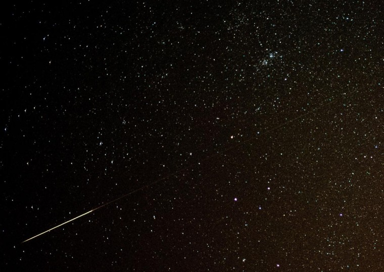 A shooting star can be seen in the night sky over Sieversdorf, eastern Germany, on August 11, 2013. The peak of the Perseid meteor shower is expected for the night to Tuesday, August 13, 2013. (Patrick Pleul/AFP/Getty Images)