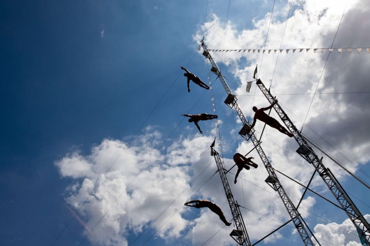 Synchronized acrobats jump from heights of seven, eight 15 and 23 meters into a water basin at a theme park in Geiselwind, southern Germany, on August 13, 2013. (Daniel Karmann/AFP/Getty Images)