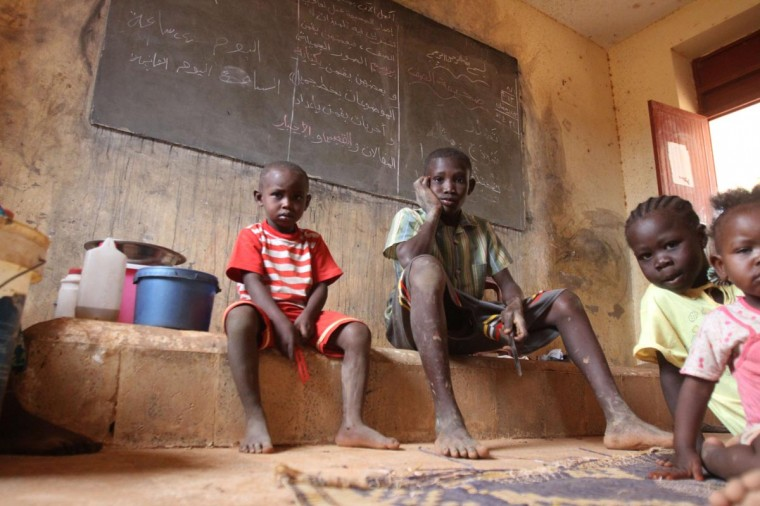 Children shelter in a classroom following heavy rains in Omdurman on August 13, 2013. The number of people affected by this month's flooding which started on August 1st in Sudan has climbed to around 150,000 and is expected to rise further, the United Nations said, with more than half the victims, 84,000, in the area around the capital Khartoum. (Ashraf Shazly/AFP/Getty Images)