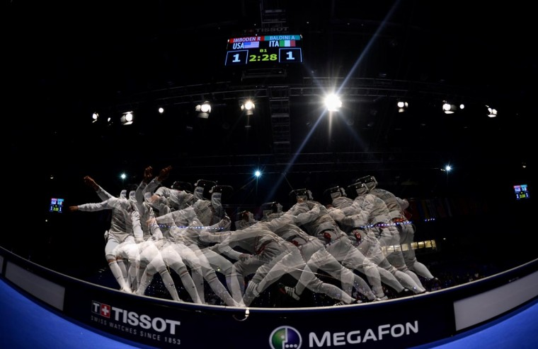 A multi-exposure photo shows Italy's Andrea Baldini (R) fighting with Race Imboden (L) of the US during the men's team foil competition at the 2013 World Fencing Championships in Budapest on August 12, 2013. The team of Italy won the gold medal, the US took silver, France placed third. (Attila Kisbenedk/AFP/Getty Images)