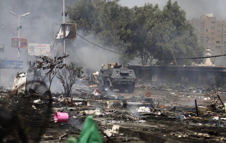 An Egyptian security forces' armoured vehicle drives amidst remains of a protest camp by supporters of ousted president Mohamed Morsi and members of the Muslim Brotherhood after a crackdown on August 14, 2013 near Cairo's Rabaa al-Adawiya mosque. (Khaled Desouki/AFP/Getty Images)