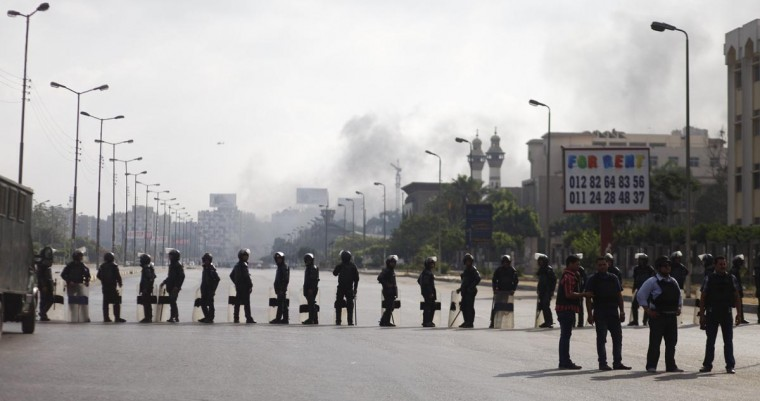 Egyptian security forces cordon off an area near Cairo's Rabaa al-Adawiya mosque after a police crackdown on a protest camp by supporters of ousted president Mohamed Morsi and members of the Muslim Brotherhood on August 14, 2013. (Khaled Desouki/AFP/Getty Images)