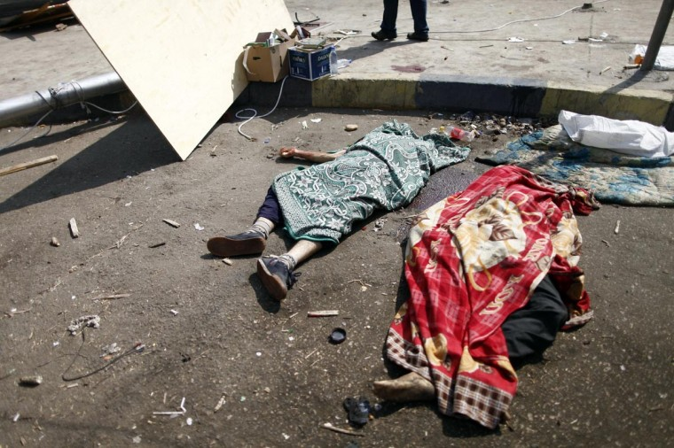 Dead bodies lie on the ground after an Egyptian police crackdown on a protest camp by supporters of ousted president Mohamed Morsi and members of the Muslim Brotherhood on August 14, 2013 near Cairo's Rabaa al-Adawiya mosque. (Khaled Desouki/AFP/Getty Images)