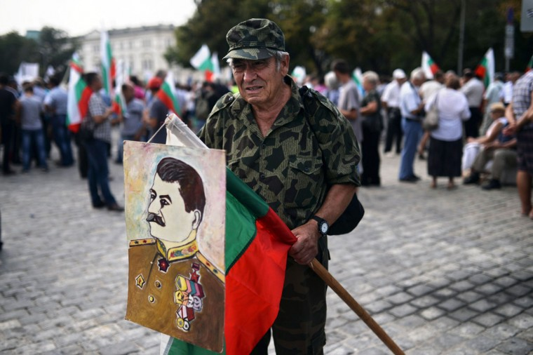 A supporter of the Bulgarian Socialist party holds a portrait of Soviet dictator Joseph Stalin during a rally to support the government in downtown Sofia on August 16, 2013. Technocrat Prime Minister Plamen Oresharski faces a stern test when his revised 2013 budget goes before parliament again after it was vetoed by the president. (Dimitar Dilkoff/AFP/Getty Images)