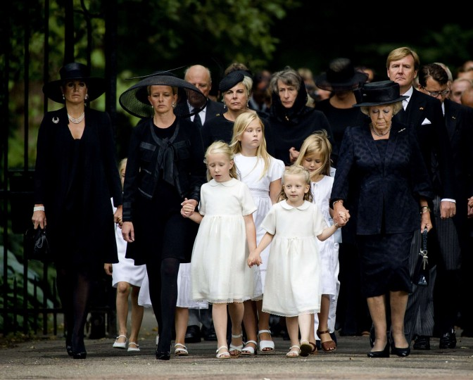 Dutch Princess Mabel Wisse-Smit (second left) walks with her daughters Luana and Zaria, Princess Beatrix, the royal family and guests to the Stulp Church in Lage Vuursche in Baarn, The Netherlands, on August 16, 2013 where the funeral service of Prince Friso will be held. The prince will be buried in the cemetery of the church in Lage Vuursche. The prince, who spent the last 18 months in a coma after being caught in an avalanche, died aged 44, royal officials announced 12 August. The younger brother of King Willem-Alexander suffered severe brain damage in February 2012 after the skiing accident in the Austrian ski resort of Lech. (Robin van Lonkhuijsen/AFP/Getty Images)