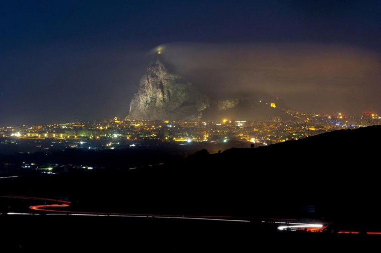 This long-exposure photograph taken on August 18, 2013 from the Mirador del Higueron in La Linea de la Concepcion shows the Rock of Gibraltar. Spain ceded Gibraltar to Britain in perpetuity in 1713 but has long argued that it should be returned to Spanish sovereignty. London says it will not do so against the wishes of Gibraltarians, who are staunchly pro-British. (Marcos Moreno/AFP/Getty Images)