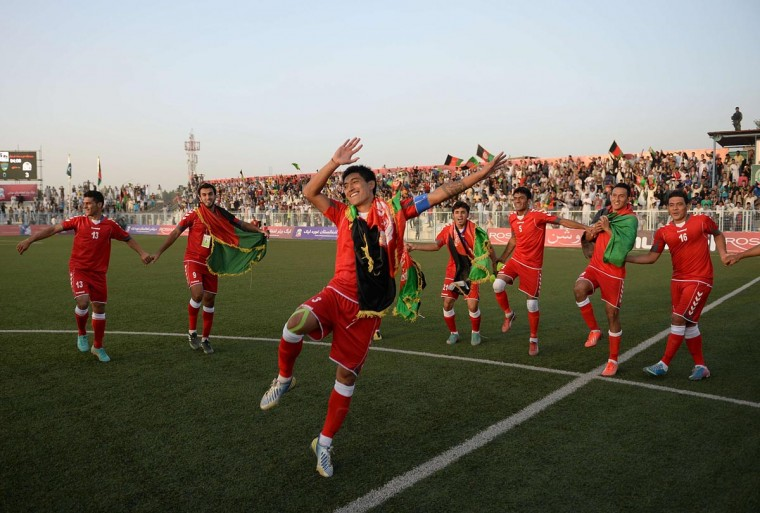 Afghan footballers celebrate their 3-0 win against Pakistan at the Afghanistan Football Federation (AFF) stadium in Kabul on August 20, 2013. Afghanistan's football team sparked rowdy celebrations across the war-battered nation on August 20 after securing an convincing 3-0 win over arch-rivals Pakistan in the first international match in Kabul for ten years. (Massoud Hossaini/AFP/Getty Images)