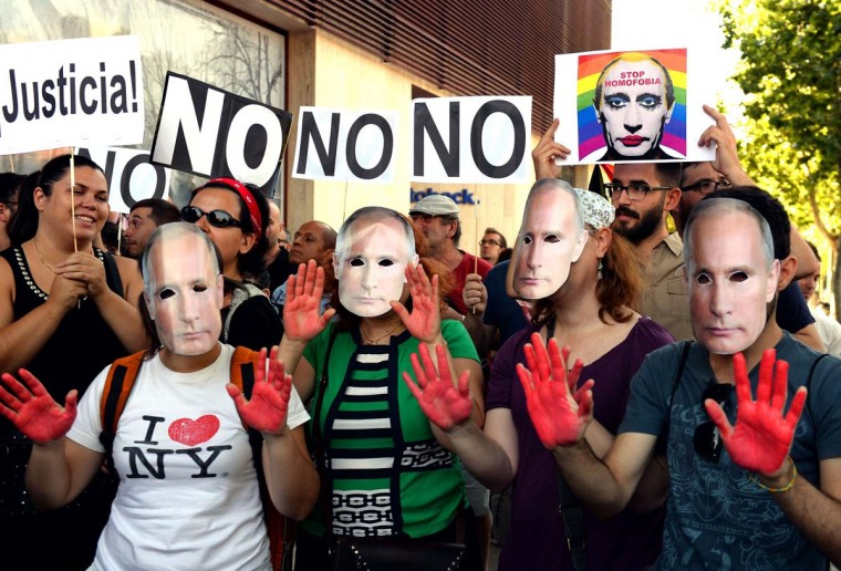 Demonstrators wearing masks depicting Russian President Vladimir Putin protest against homophobia and repression against gays in Russia in front of the Russian Embassy in Madrid on Aug. 23, 2013. (Gerard Juliena / AFP/Getty Images)