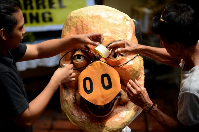 Activists apply finishing touches on an effigy of Philippine President Benigno Aquino in Manila on August 25, 2013. Demonstrators made preparations ahead of a nationwide protest on August 26 against corruption over miss-spending of government funds. (Noel Celis/AFP/Getty Images)