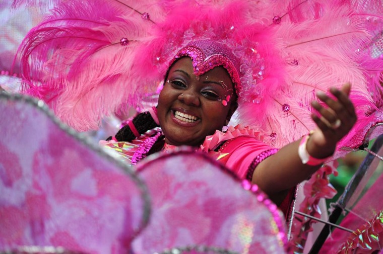 A performer takes part in the parade on the second day of the Notting Hill Carnival in west London on August 26, 2013. Running over two days, the Caribbean carnival puts on a Kid's day on the Sunday when costume prizes are awarded and a 'main parade' day on the Monday. (Carl Court/AFP)
