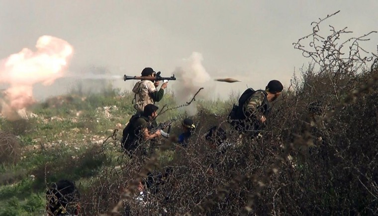 An image grab taken from a video shows an opposition fighter firing an rocket propelled grenade (RPG) on August 26, 2013 during clashes with regime forces over the strategic area of Khanasser, situated on the only road linking Aleppo to central Syria. (Salah Al-Ashkar/AFP/Getty Images)