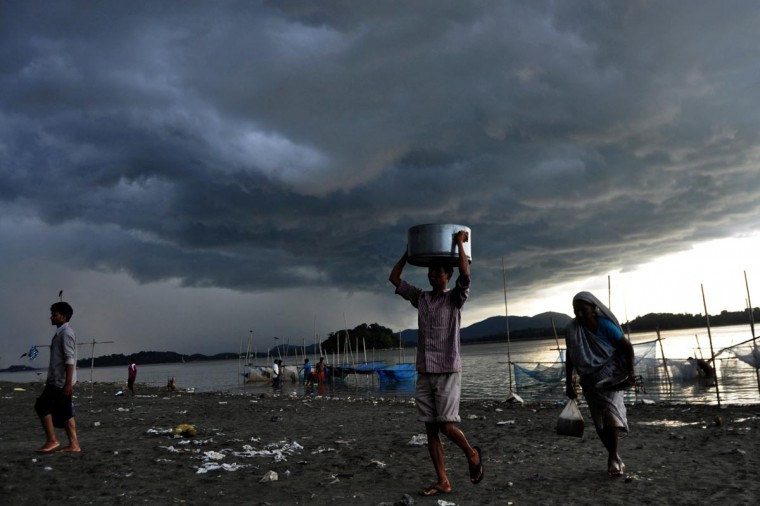 Rain clouds loom over the Brahmaputra river in Guwahati, capital of northeastern Assam state, on August 27, 2013. The monsoon season, which runs from June to September, accounts for about 80 percent of India's annual rainfall, vital for a farm economy which lacks adequate irrigation facilities. (Biju Boro/AFP/Getty Images)